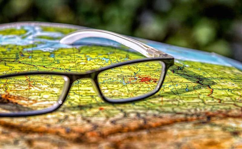 Glasses on top of a map