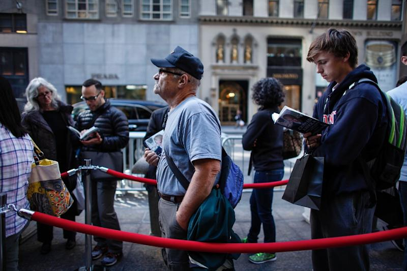 """A two-block queue greeted those who turned up to meet Republican presidential candidate Donald Trump on November 3, 2015, as he launched his book """"Crippled America"""" at a New York event (AFP Photo/Kena Betancur)"""