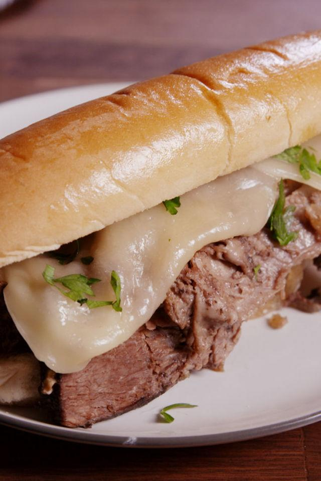 "<p>Slow cooked for hours, this French dip is tender AF.</p><p>Get the recipe from <a rel=""nofollow"" href=""http://www.delish.com/cooking/recipe-ideas/recipes/a49346/slow-cooker-french-dip-recipe/"">Delish</a>.</p>"