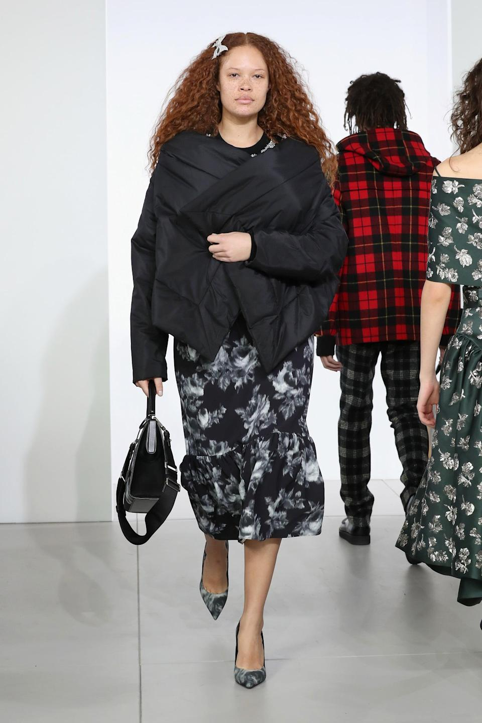 <p>Instagram sensation and Afro-Swedish model Sabina Karlsson's freckles and wild red hair have caught the eye of Christian Siriano and Michael Kors. Having modeled since she was a child, Karlsson has seen a shift in the industry both for both Black and curve models but remains a strong voice for inclusion and change.</p>