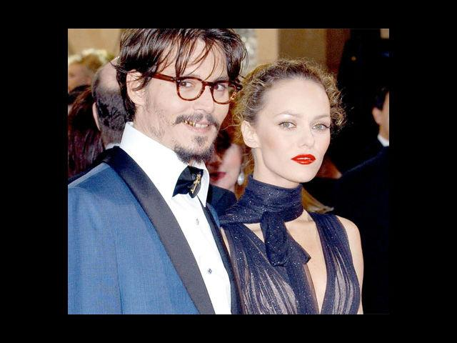 <b>2. Johnny Depp and Vanessa Paradis</b><br> The heartthrob of all ages, Johnny 'Sweeney' Depp broke up with his wife Vanessa Paradis back in June of this year. The year started with rumours about their split doing the rounds. Denial is what we got to hear first, until the split materialized. Johnny Depp however, is rumoured to have gotten close to his 'The Rum Diary' co-star Amber Heard. Assuming this one isn't a false rumour, that's quite a catch! Way to go Johnny!