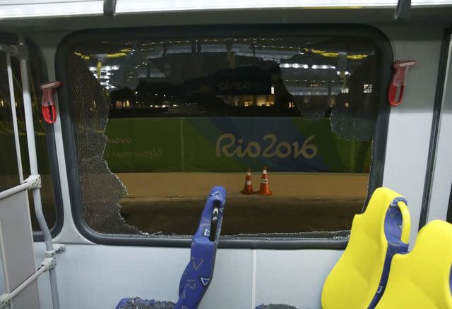 The window on an Olympic media bus after it shattered when driving journalists. (Reuters)