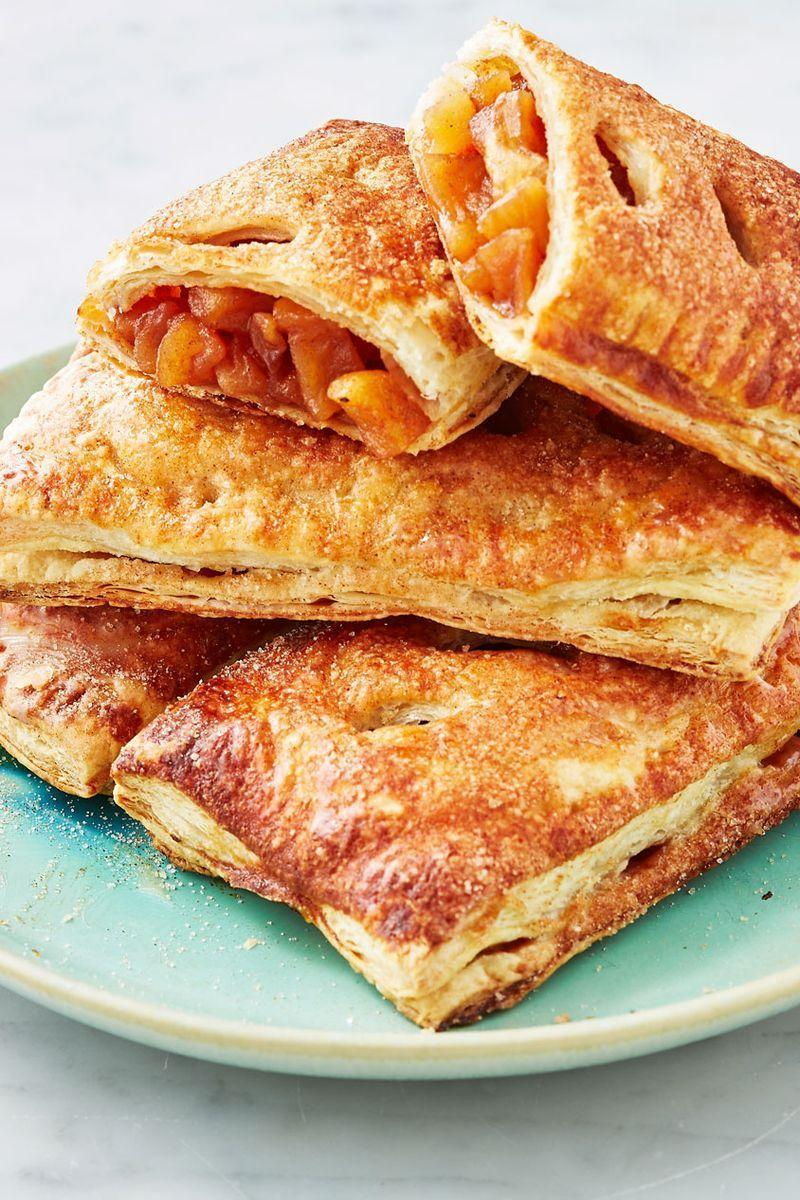 """<p>Our take on McDonald's apple pie skips the deep fry and is baked instead for a better take on the restaurant favourite. We used puff pastry so you still get all of those flaky layers and buttery crust. </p><p>Get the <a href=""""https://www.delish.com/uk/cooking/recipes/a29756533/mcdonalds-apple-pie-recipe-del0313/"""" rel=""""nofollow noopener"""" target=""""_blank"""" data-ylk=""""slk:McDonald's Apple Pie"""" class=""""link rapid-noclick-resp"""">McDonald's Apple Pie</a> recipe.</p>"""