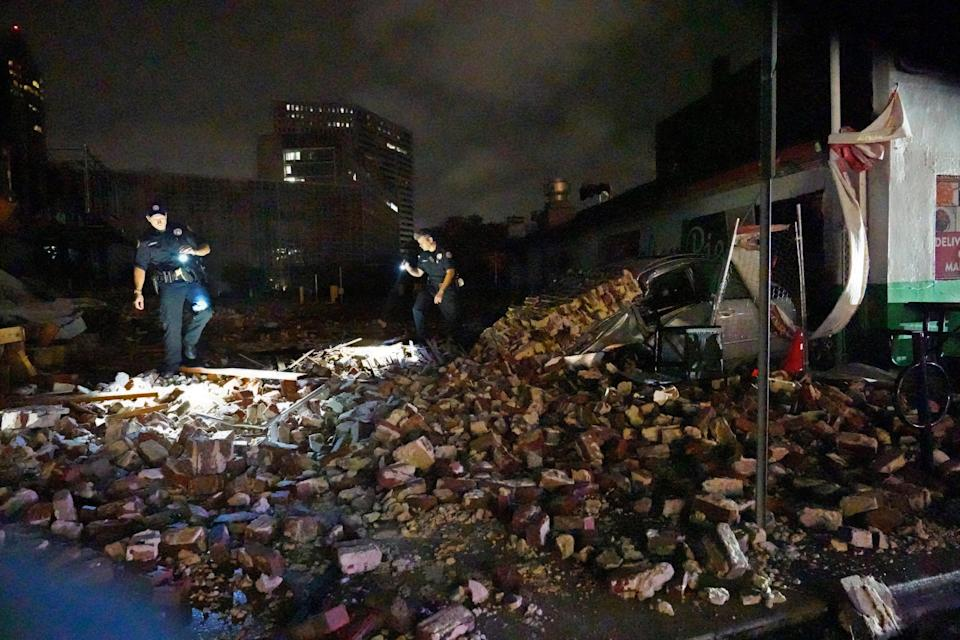 New Orleans Police detectives look over debris from a building that collapsed (AP Photo/Gerald Herbert)