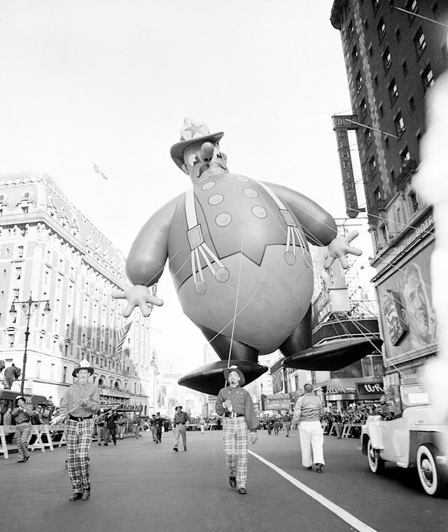 <p>A huge balloon in the form of comic fireman floats over Broadway during the annual Macy's Thanksgiving Day Parade in New York, Nov. 25, 1948. (Photo: John Rooney/AP) </p>