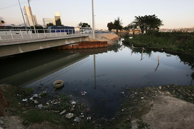 A polluted canal stands next to the Olympic Park. (Getty Images)