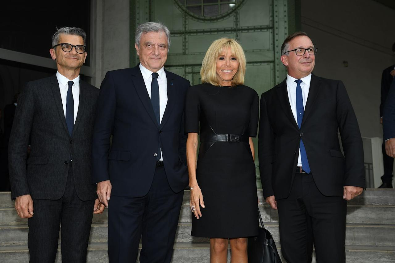 <p>The French first lady paid tribute to the late Karl Lagerfeld at his memorial wearing a belted black shift dress. </p>