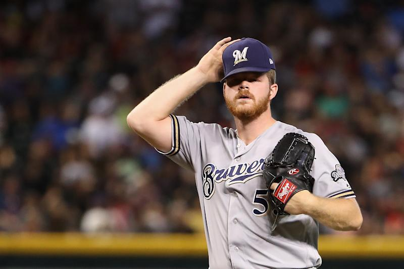 PHOENIX, ARIZONA - JULY 21: Starting pitcher Brandon Woodruff #53 of the Milwaukee Brewers reacts after giving up a two-run home run to Alex Avila (not pictured) of the Arizona Diamondbacks during the second inning of the MLB game at Chase Field on July 21, 2019 in Phoenix, Arizona. (Photo by Christian Petersen/Getty Images)