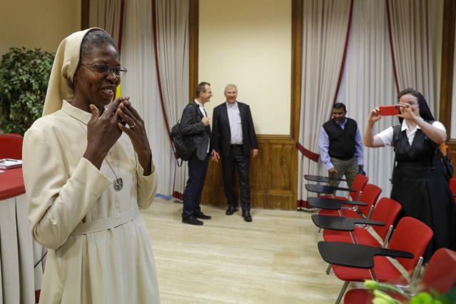 Togolese Sister Makamatine Lembo receives congratulations after she successfully defended her dissertation on the sexual abuse of religious sisters by priests, at the Pontifical Gregorian University, in Rome, Thursday, Sept. 26, 2019. Sister Lembo was awarded summa cum laude, and was praised by her examiners for her courage in examining such a taboo subject. (AP Photo/Gregorio Borgia)