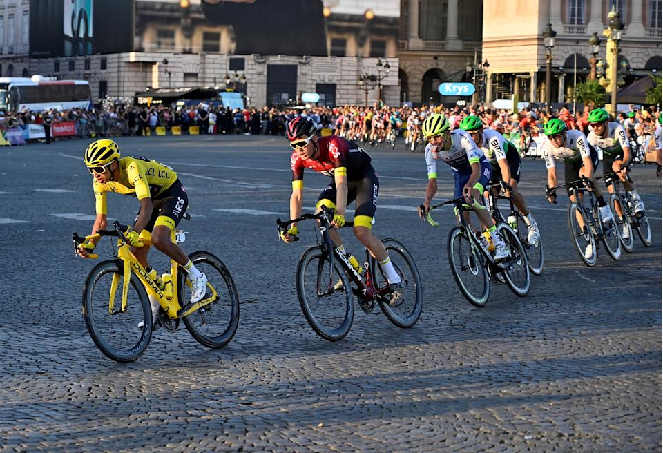 PARIS, FRANCE - JULY 28: Egan Bernal, left,(Team INEOS) of Colombia competes on the Champs-Elysees avenue during the Paris Champs-Elysees stage of the Tour de France 2019 in Paris, France on July 28, 2019.  (Photo by Mustafa Yalcin/Anadolu Agency via Getty Images)
