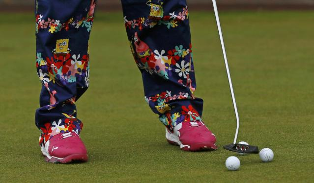 John Daly of the U.S. putts on the putting green during a practice round ahead of the British Open Championship at the Royal Liverpool Golf Club in Hoylake, northern England July 16, 2014. REUTERS/Stefan Wermuth (BRITAIN - Tags: SPORT GOLF TPX IMAGES OF THE DAY)
