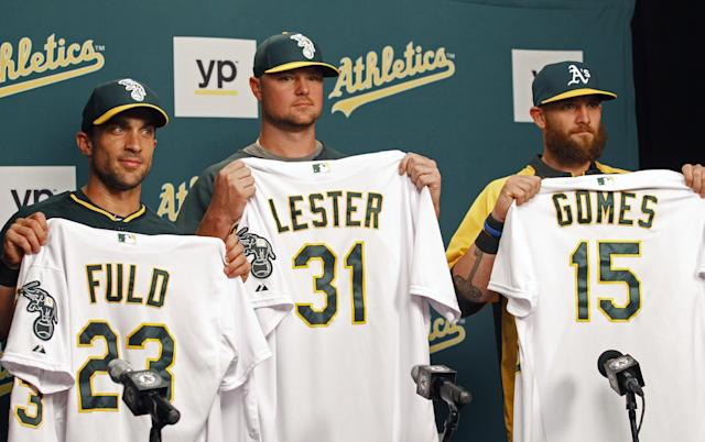 Oakland Athletics new acquisitions, from left, Sam Fuld, Jon Lester and Jonny Gomes show off their new jerseys at a news conference, Friday, Aug. 1, 2014 in Oakland, Calif. The Athletics acquired Lester and Gomes from the Boston Red Sox for outfielder Yoenis Cespedes. (AP Photo/George Nikitin)