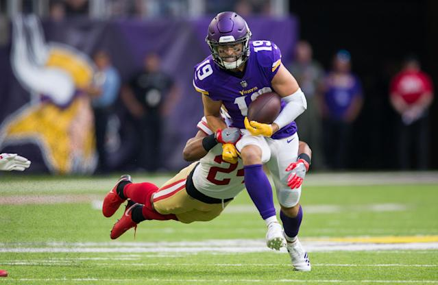 <p>Minnesota Vikings wide receiver Adam Thielen (19) runs after the catch in the first quarter against San Francisco 49ers defensive back K'Waun Williams (24) at U.S. Bank Stadium. Mandatory Credit: Brad Rempel-USA TODAY Sports </p>