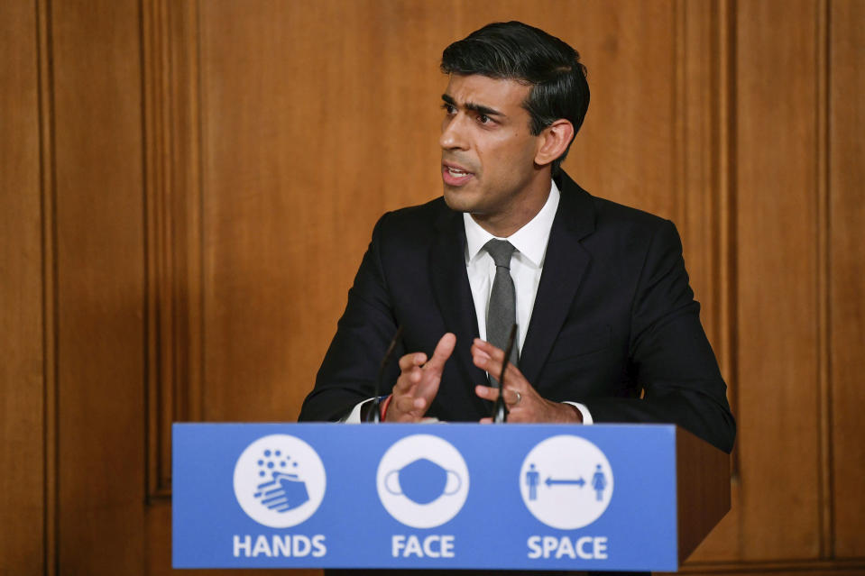 Britain's Chancellor of the Exchequer Rishi Sunak speaks, during a coronavirus briefing in Downing Street, London, Monday, Oct. 12, 2020. (Toby Melville/Pool Photo via AP)