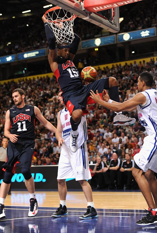 MANCHESTER, ENGLAND - JULY 19: USA player Carmelo Anthony scores a basket during the Men's Exhibition Game between USA and Team GB at Manchester Arena on July 19, 2012 in Manchester, England. (Photo by Stu Forster/Getty Images)