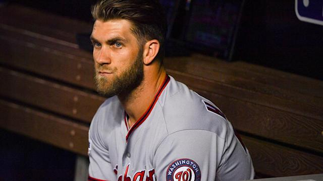 Bryce Harper was not happy that rumored Nationals trade target J.T. Realmuto helped beat them Saturday night. (AP)