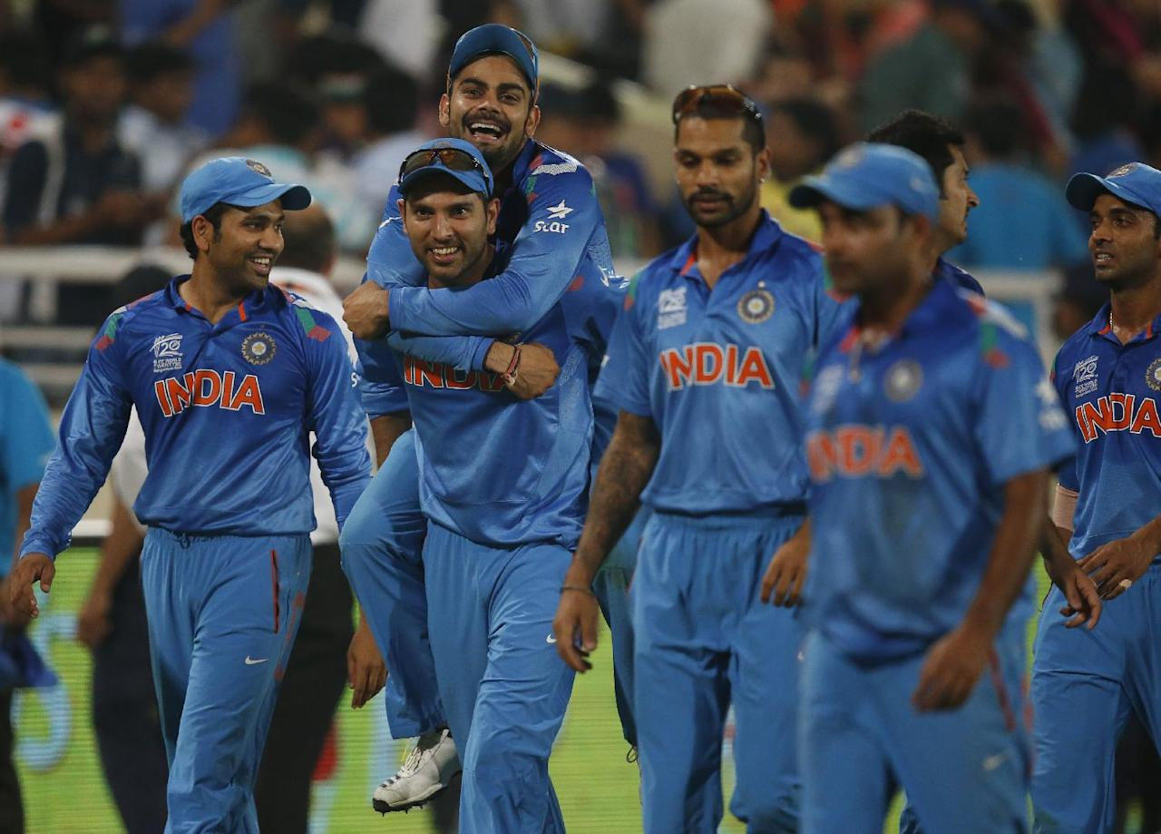India's Yuvraj Singh, second left, carries teammate Virat Kohli on his back as they celebrate their win over Australia in their ICC Twenty20 Cricket World Cup match in Dhaka, Bangladesh, Sunday, March 30, 2014. India won the match by 73 runs. (AP Photo/Aijaz Rahi)