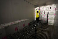 FILE - In this Dec. 20, 2020, file photo, boxes containing the Moderna COVID-19 vaccine are loaded into a truck for shipping at the McKesson distribution center in Olive Branch, Miss. As millions continue to wait their turn for the COVID-19 vaccine, small but steady amounts of the precious doses have gone to waste across the country. By one World Health Organization estimate, more than half of all vaccines in previous campaigns worldwide have been thrown away because they were mishandled, unclaimed or expired. (AP Photo/Paul Sancya, Pool, File)