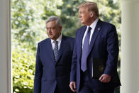 President Donald Trump and Mexican President Andres Manuel Lopez Obrador arrive for an event in the Rose Garden at the White House, Wednesday, July 8, 2020, in Washington. (AP Photo/Evan Vucci)
