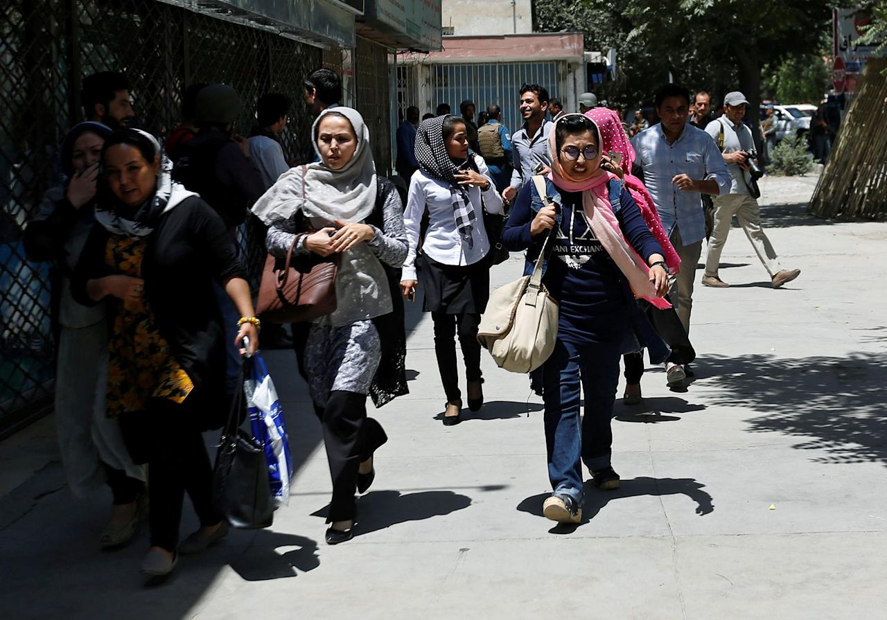 <p>Afghan women run away after a blast and gun fire at the site of an attack in Kabul, Afghanistan July 31, 2017. (Mohammad Ismail/Reuters) </p>