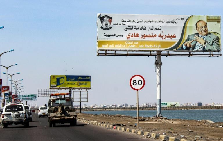 Yemen's Saudi-backed President Abedrabbo Mansour Hadi, pictured on a billboard on a road in the Red Sea port of Aden, fled the city in 2015 (AFP Photo/Saleh Al-OBEIDI)
