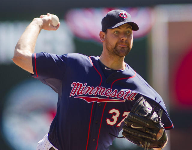 Minnesota Twins starting pitcher Mike Pelfrey (37) throws against the Oakland Athletics in the first inning of a baseball game on Thursday, April 10, 2014 in Minneapolis.(AP Photo/Andy Clayton-King)