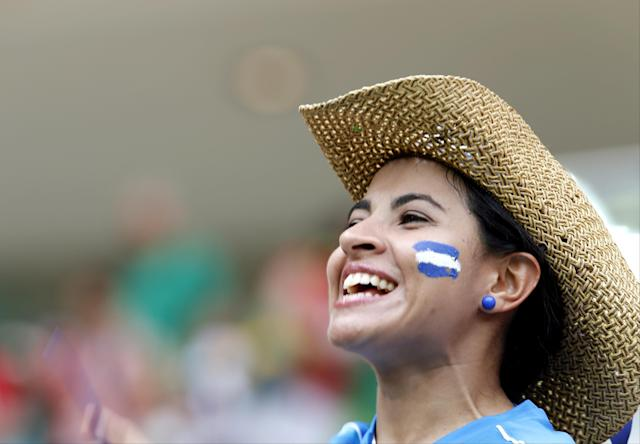 A Honduras fan cheers before the group E World Cup soccer match between Honduras and Switzerland at the Arena da Amazonia in Manaus, Brazil, Wednesday, June 25, 2014. (AP Photo/Dolores Ochoa)
