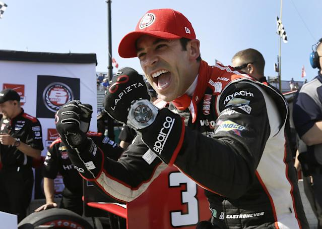 Driver Helio Castroneves reacts after exiting his car after qualifying for the pole position for the first IndyCar Detroit Grand Prix in Detroit, Saturday, May 31, 2014. The second race of the series is on Sunday. (AP Photo/Carlos Osorio)