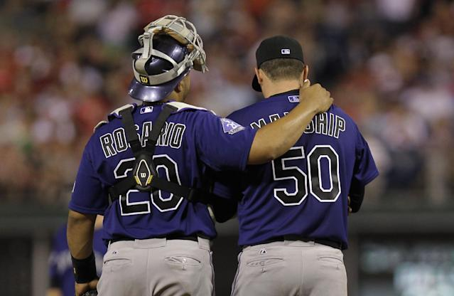 Colorado Rockies pitcher Jeff Manship talks with catcher Willin Rosario after loading the bases in a baseball game against the Philadelphia Phillies, Monday, Aug. 19, 2013, in Philadelphia. (AP Photo/Laurence Kesterson)