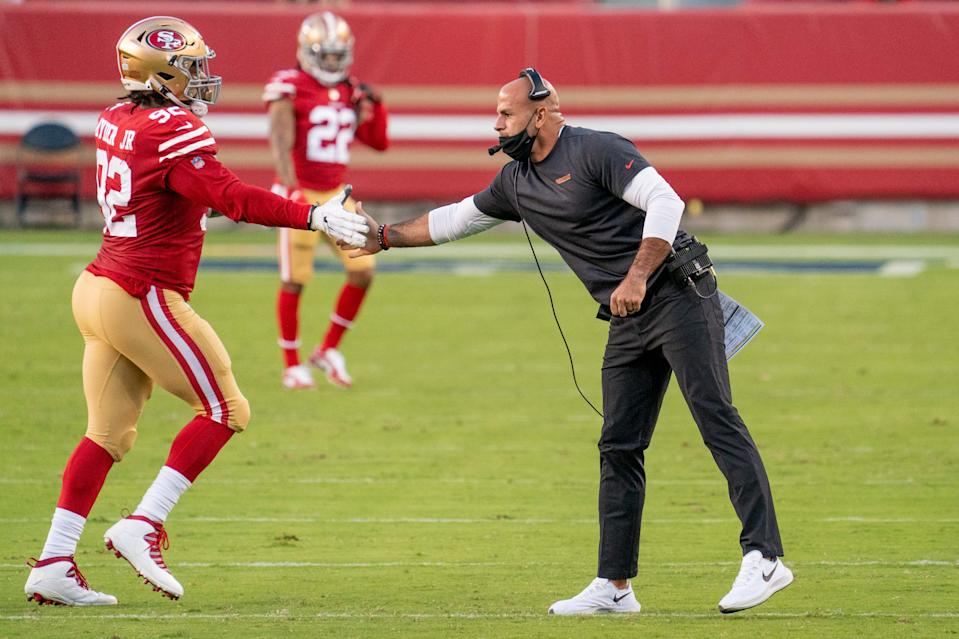 San Francisco 49ers defensive coordinator Robert Saleh high-fives defensive end Kerry Hyder during the game against the Philadelphia Eagles at Levi's Stadium, Oct. 4, 2020.