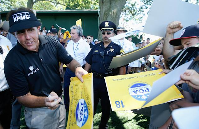 ROCHESTER, NY - AUGUST 06: Phil Mickelson signs autographs for fans during a practice round prior to the start of the 95th PGA Championship at Oak Hill Country Club on August 6, 2013 in Rochester, New York. (Photo by Scott Halleran/Getty Images)