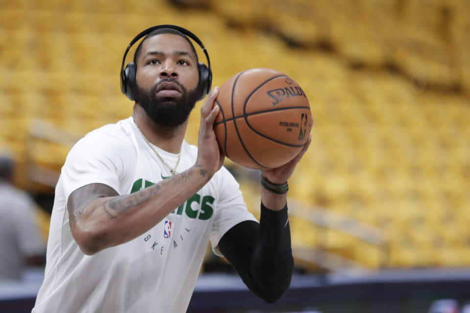 Boston Celtics forward Marcus Morris (13) shoots during warms-ups before Game 4 of an NBA basketball first-round playoff series against the Indiana Pacers in Indianapolis, Sunday, April 21, 2019. (AP Photo/Michael Conroy)