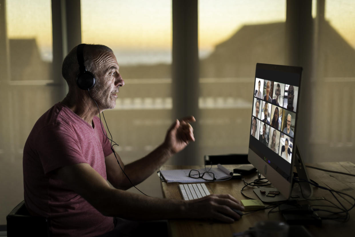 Man working from home in Zoom meeting