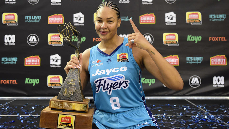 Liz Cambage, pictured here with the trophy after winning the WNBL title.