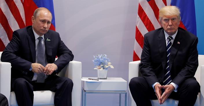 The president reportedly made the comments during his congratulatory call with Russian leader Vladimir Putin, left, last week. (Photo: Carlos Barria / Reuters)