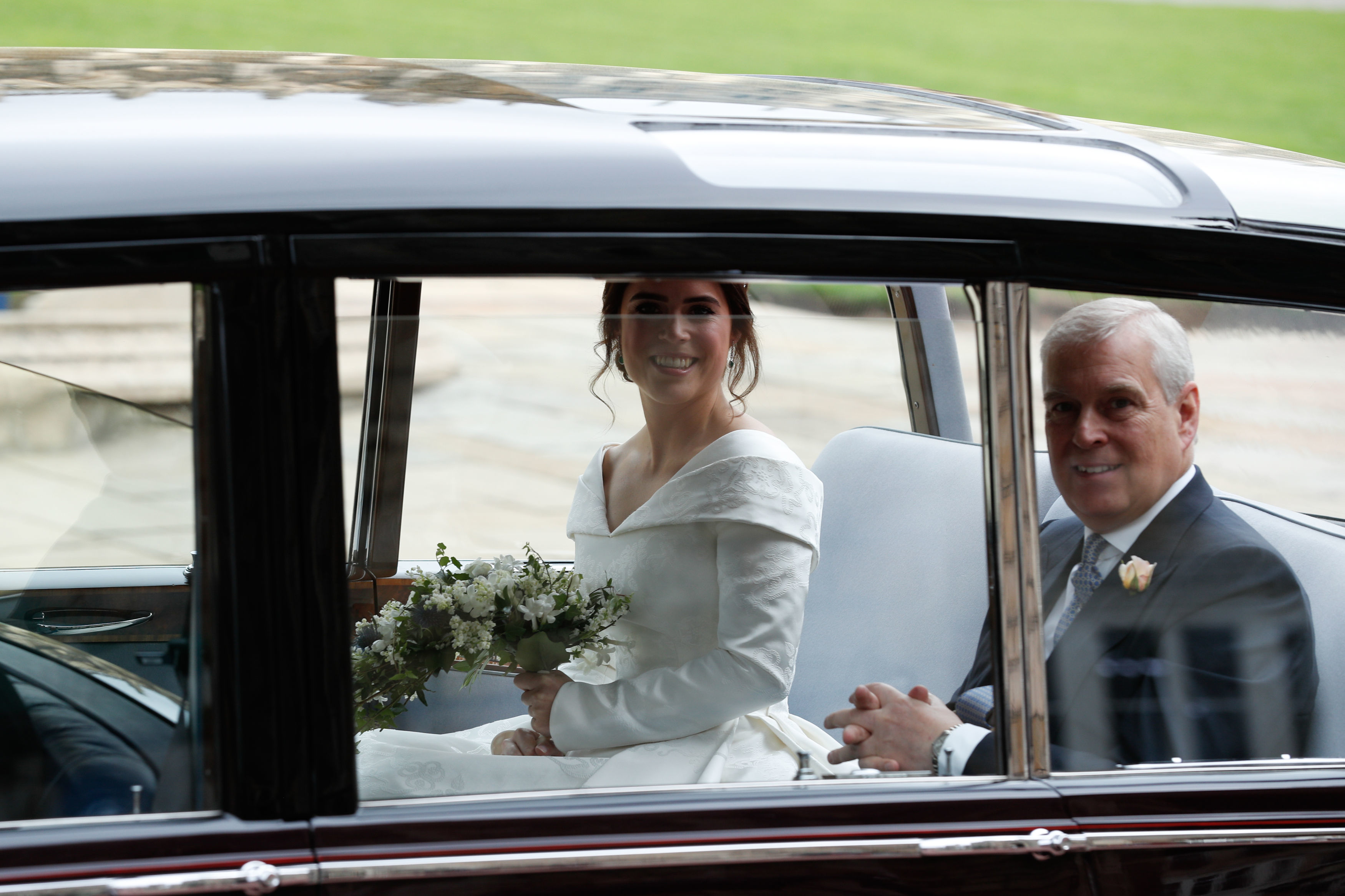 WINDSOR, ENGLAND - OCTOBER 12: The bride Princess Eugenie of York arrives with her father Prince Andrew,...