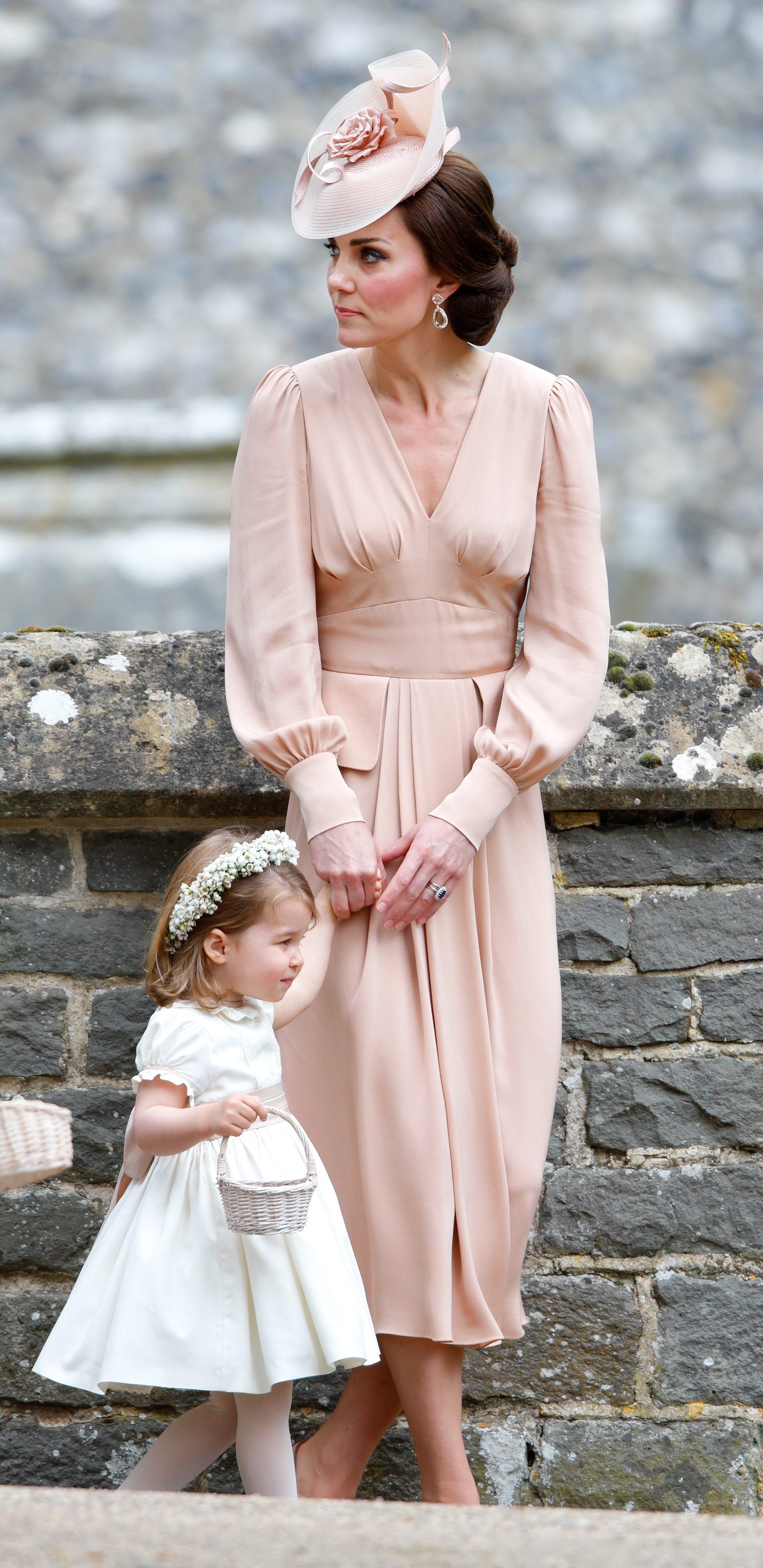 ENGLEFIELD GREEN, UNITED KINGDOM - MAY 20: (EMBARGOED FOR PUBLICATION IN UK NEWSPAPERS UNTIL 48 HOURS AFTER CREATE DATE AND TIME) Catherine, Duchess of Cambridge and Princess Charlotte of Cambridge attend the wedding of Pippa Middleton and James Matthews at St Mark's Church on May 20, 2017 in Englefield Green, England. (Photo by Max Mumby/Indigo/Getty Images)