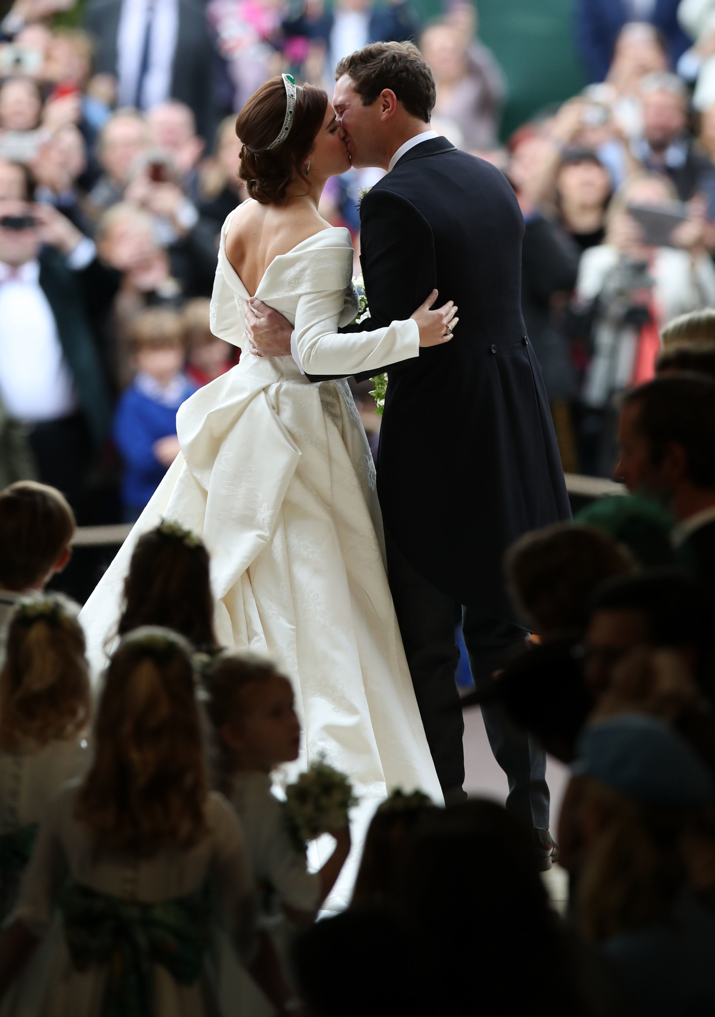 WINDSOR, ENGLAND - OCTOBER 12: Princess Eugenie of York and her new husband Jack Brooksbank kiss as they...