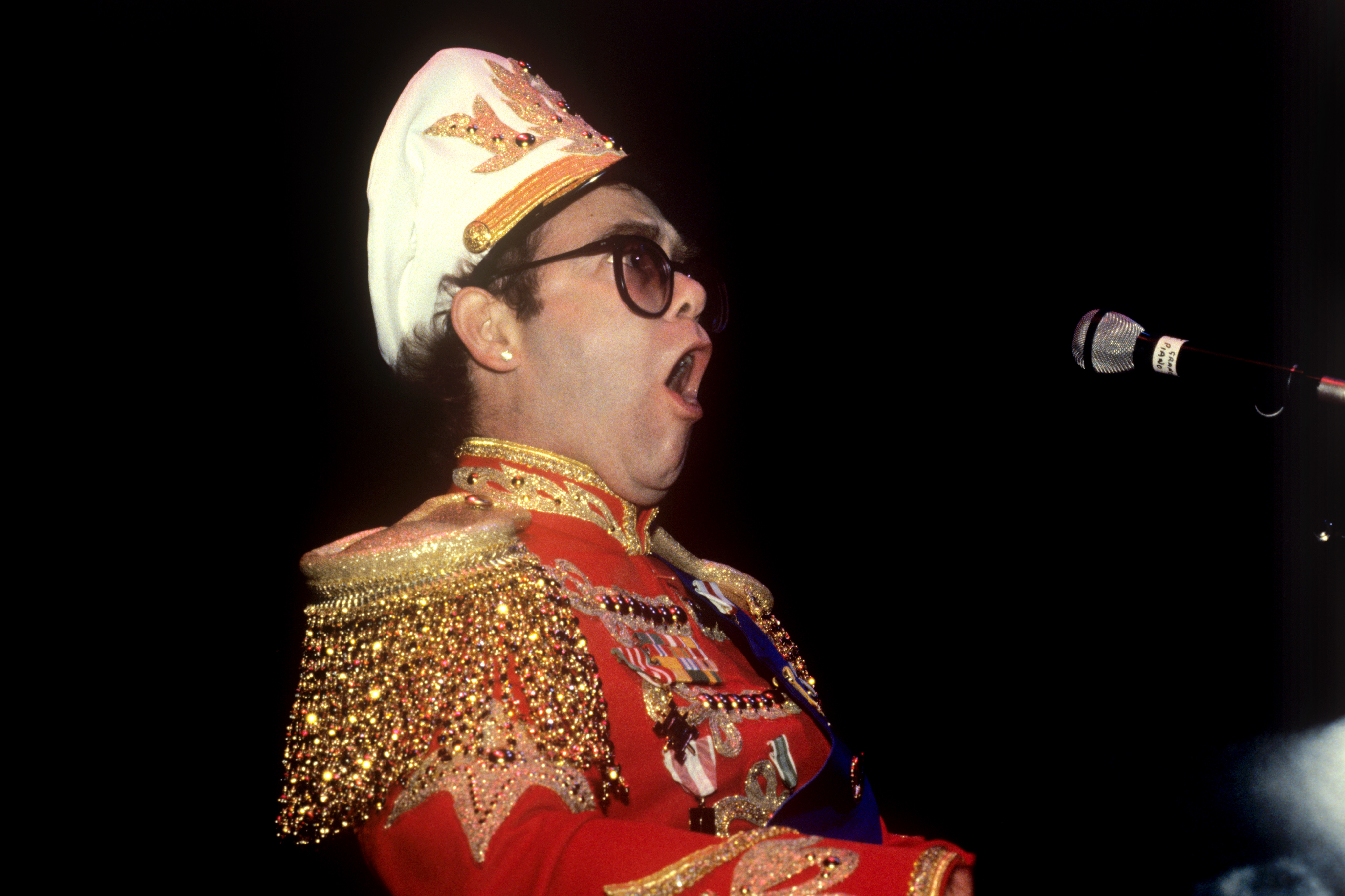 The Ruritanian look for the pop singer Elton John, showing his new uniform in London, that will be his hallmark for his British tour.