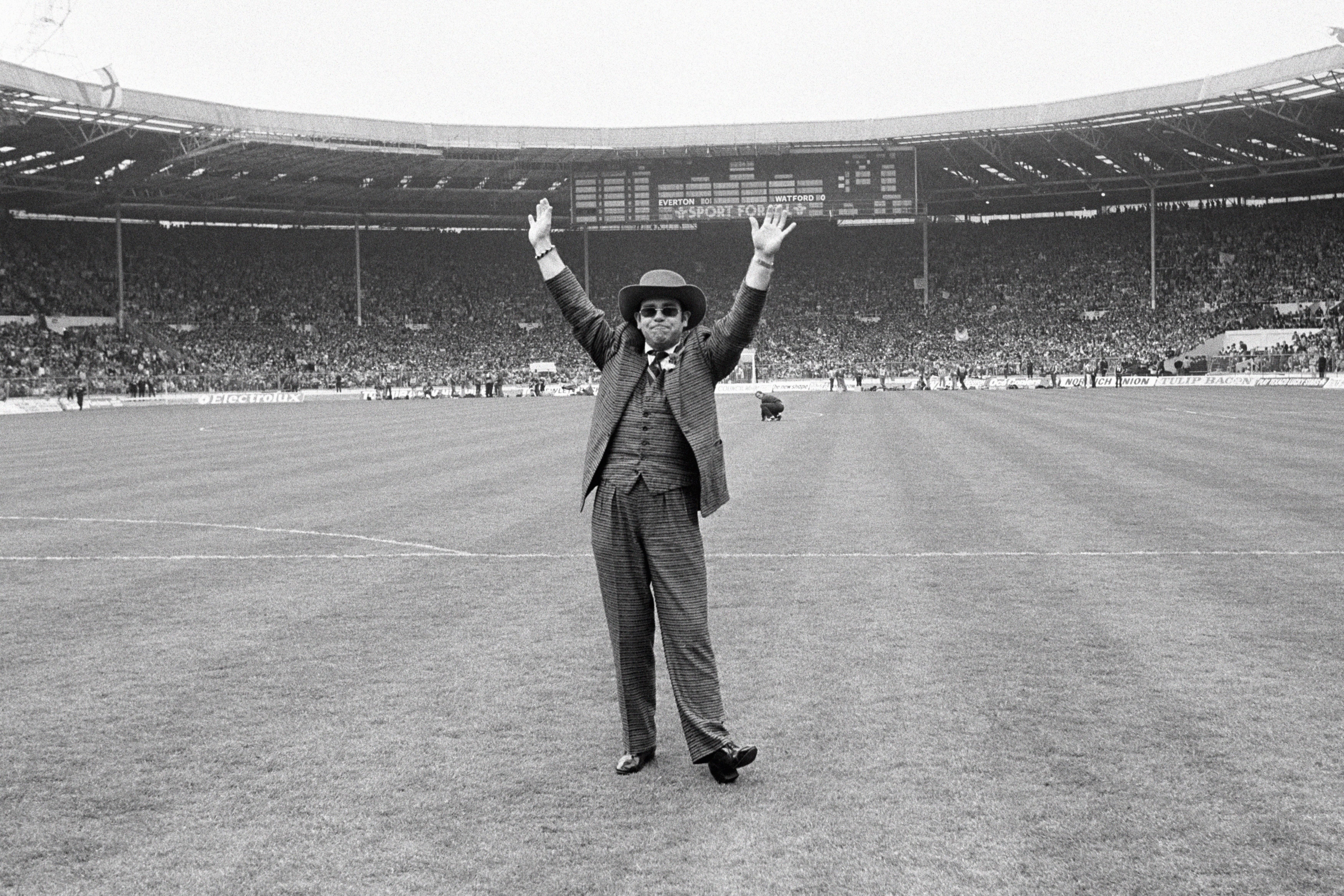 File photo dated 19-05-1984 of Watford Chairman Elton John on the pitch before the match