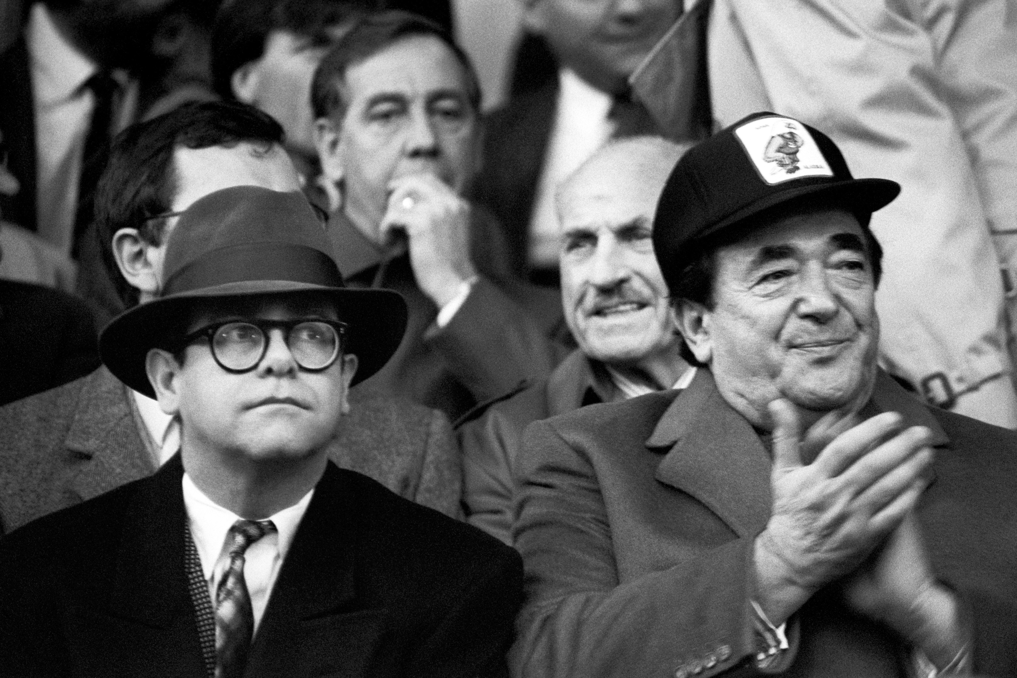 Pop star Elton John, left, who sold his controlling interest in Watford FC to Robert Maxwell for �2 million, joins the publishing tycoon in the stands at Oxford.