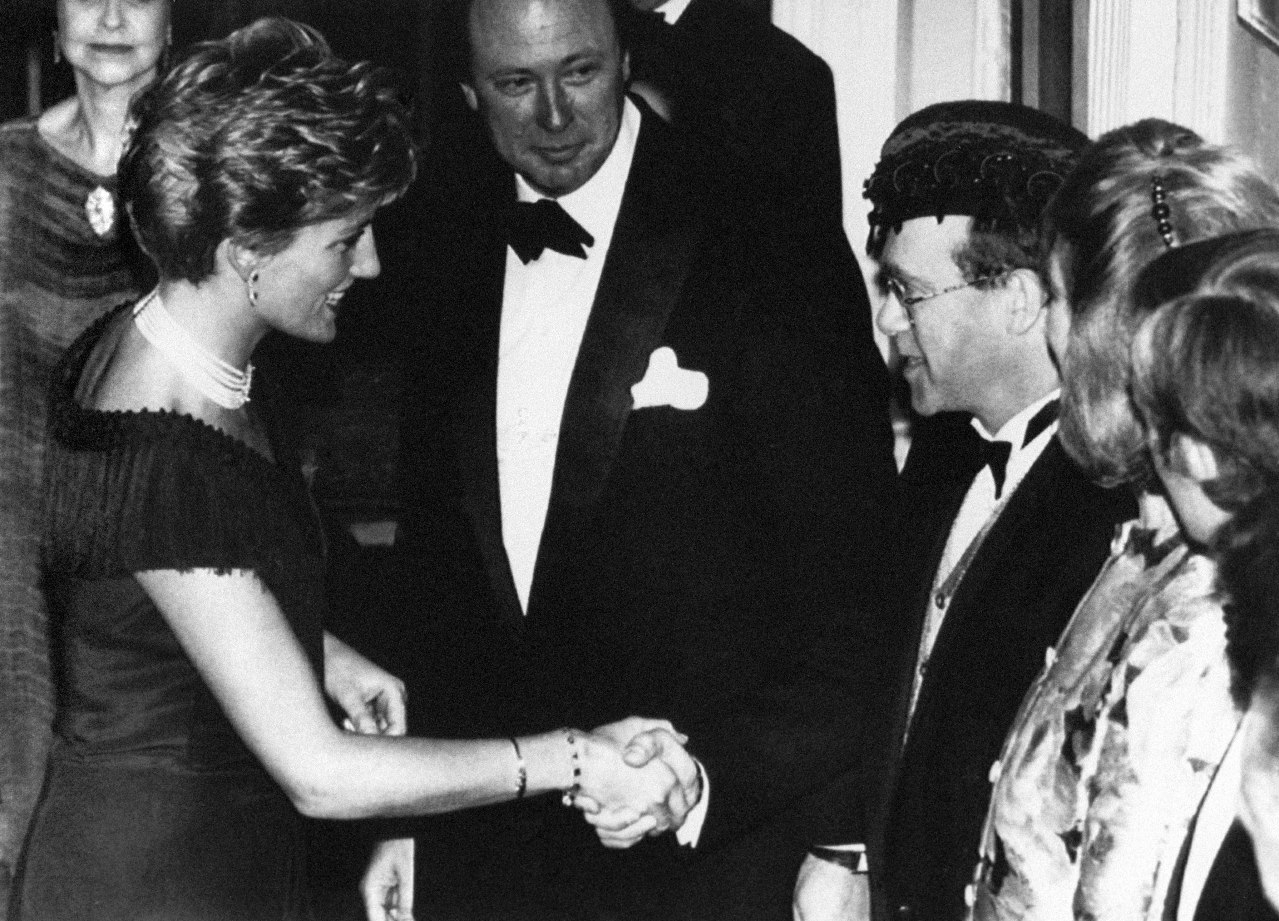 The Princess of Wales is greeted by singer Elton John for the charity premiere of the musical 'Tango Argentina' at the Aldwych Theatre, London, in aid of National Aids Trust and Aids Crisis Trust.