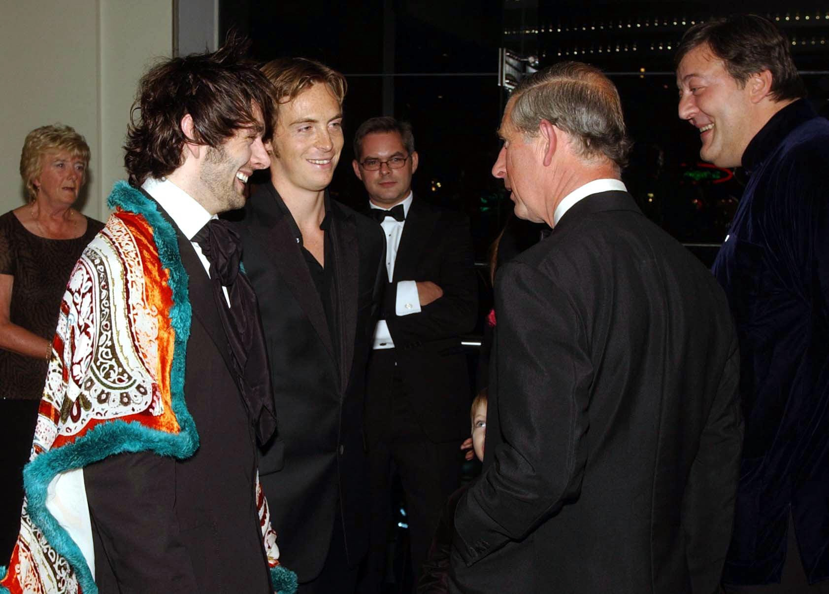 The Prince of Wales talks with actor's Michael Sheen (left), Stephen Campbell Moore and Stephen Fry (far right) at the Odeon, Leicester Square, central London, for the European Premiere of the  film 'Bright Young Things', held in aid of the Prince's Trust.