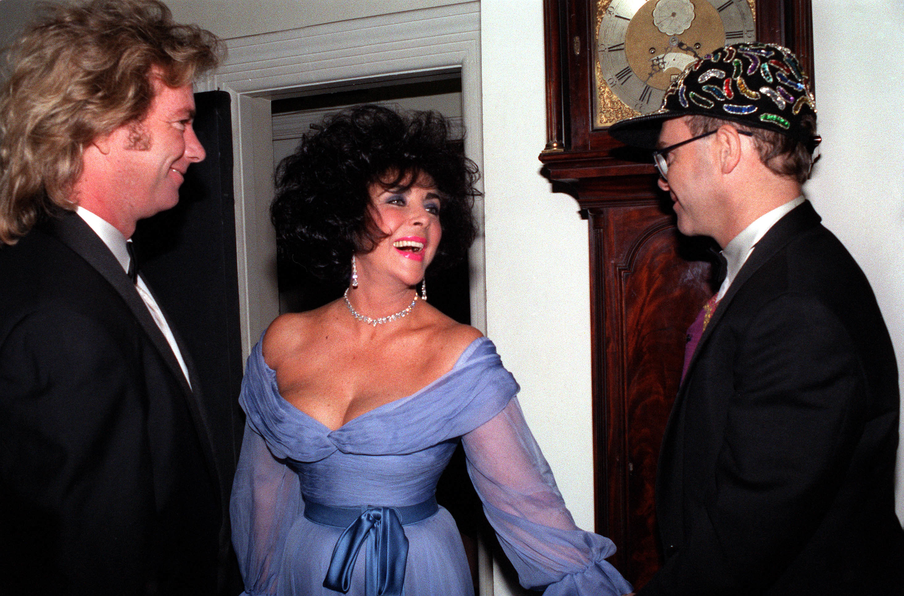 1991: Elton John (r) meet actress Elizabeth Taylor and her husband, Larry Fortensky, at a Gala reception for the Aids Trust which was attended by Princess Margaret.