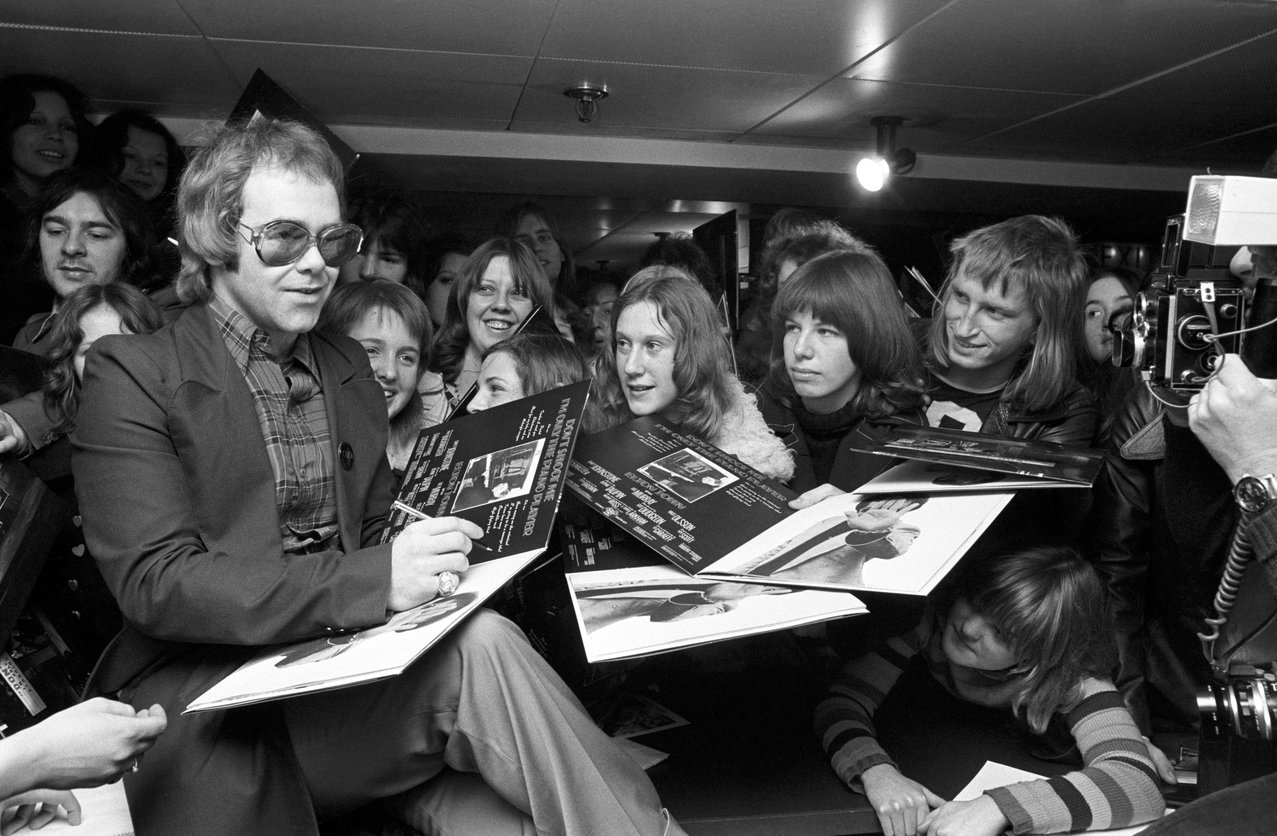 Elton John signs copies of his new album, 'Don't Shoot Me I'm Only The Piano Player' at the Noel Edmonds's Record Shop, Chelsea.