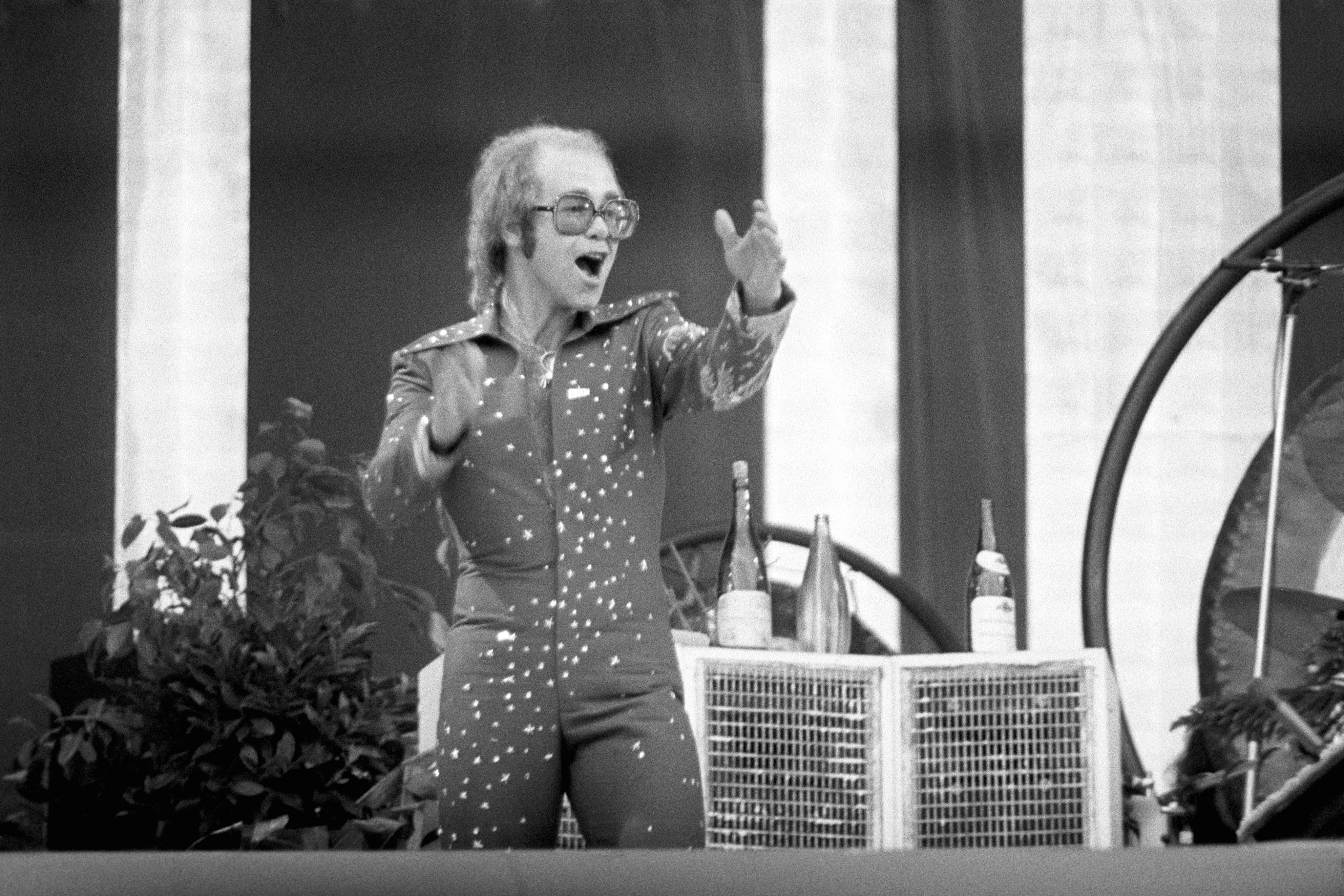 Rock star Elton John performing on stage at Wembley Stadium, Londpn