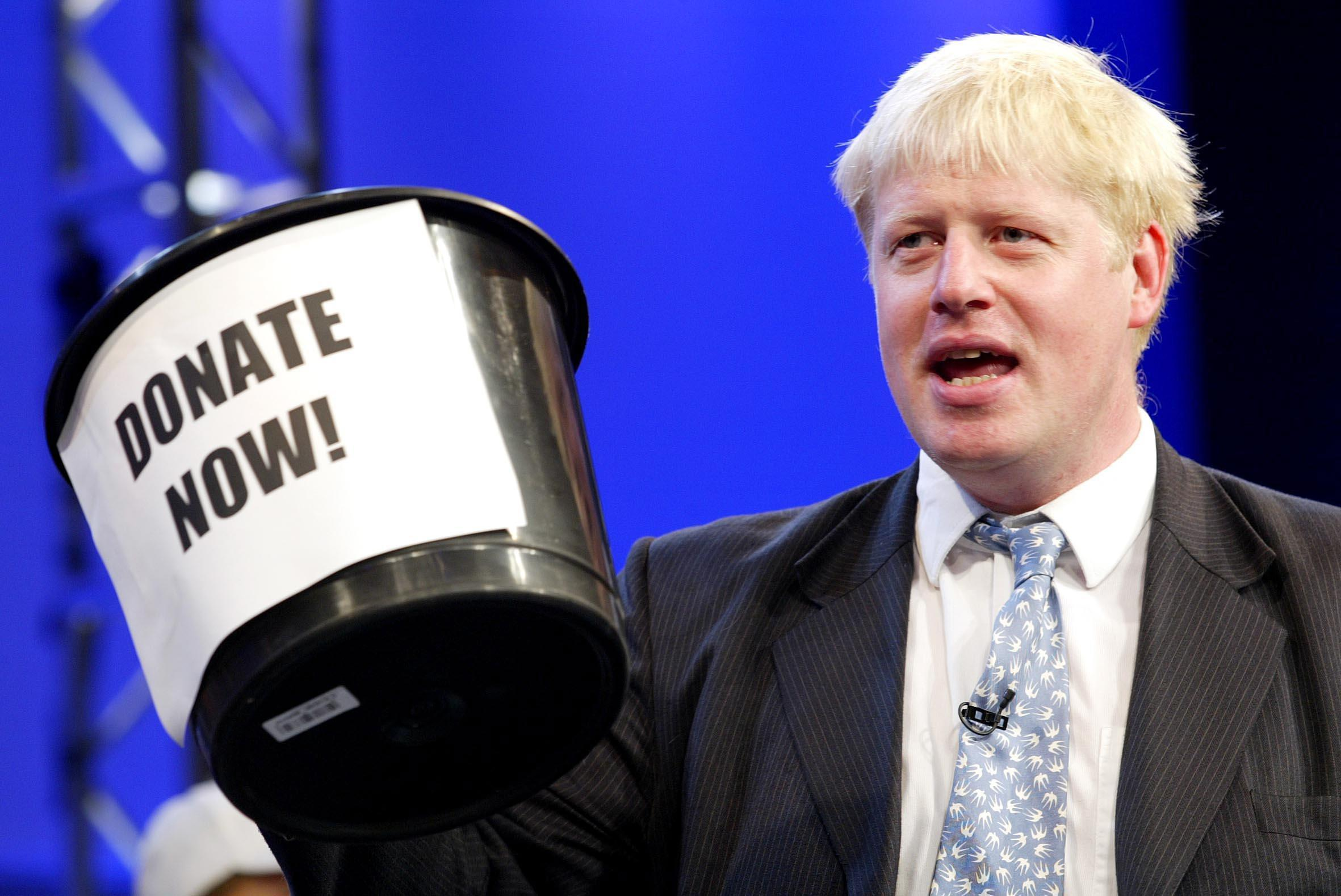 """Shadow Arts Minister Boris Johnson campaigns for donations from delegates at the Conservative Party Annual Conference in Bournemouth. 15/10/2004: Tory MP Boris Johnson who edits The Spectator magazine where a leading article has accused Liverpudlians of wallowing in what they regard as their """"victim status"""" over the murder of Ken Bigley and the Hillsborough football disaster in 1989."""