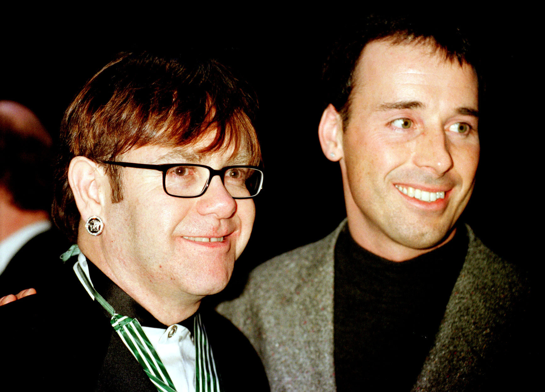"""PARIS : 19/1/97 : ELTON JOHN AND DAVID FURNISH AT THE THEATRE NATIONAL IN PARIS AFTER THE PERFORMANCE OF """"LE PRESBYTERE N'A RIEN PERDU SON CHARME NI LE JARDIN DE SON ECLAT"""". PA NEWS PHOTO BY DAVE CHESKIN."""
