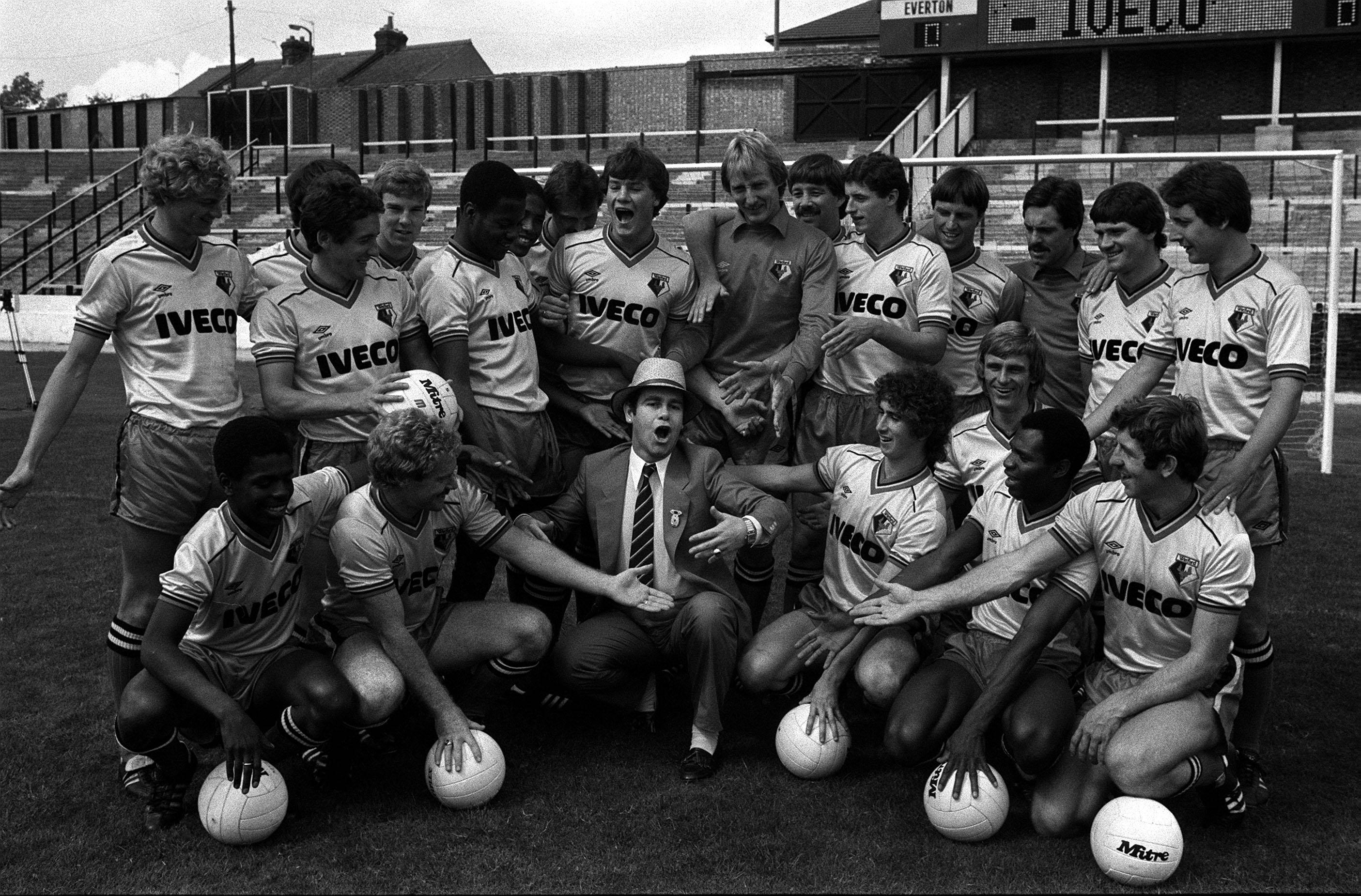 1982: Chairman Elton John leads his first team squad in a song at Vicarage Road as Watford get ready for their first 1st Division clash against Everton on Saturday at home. The club announced a  400,000 sponsorship deal with truck and bus giants Iveco.