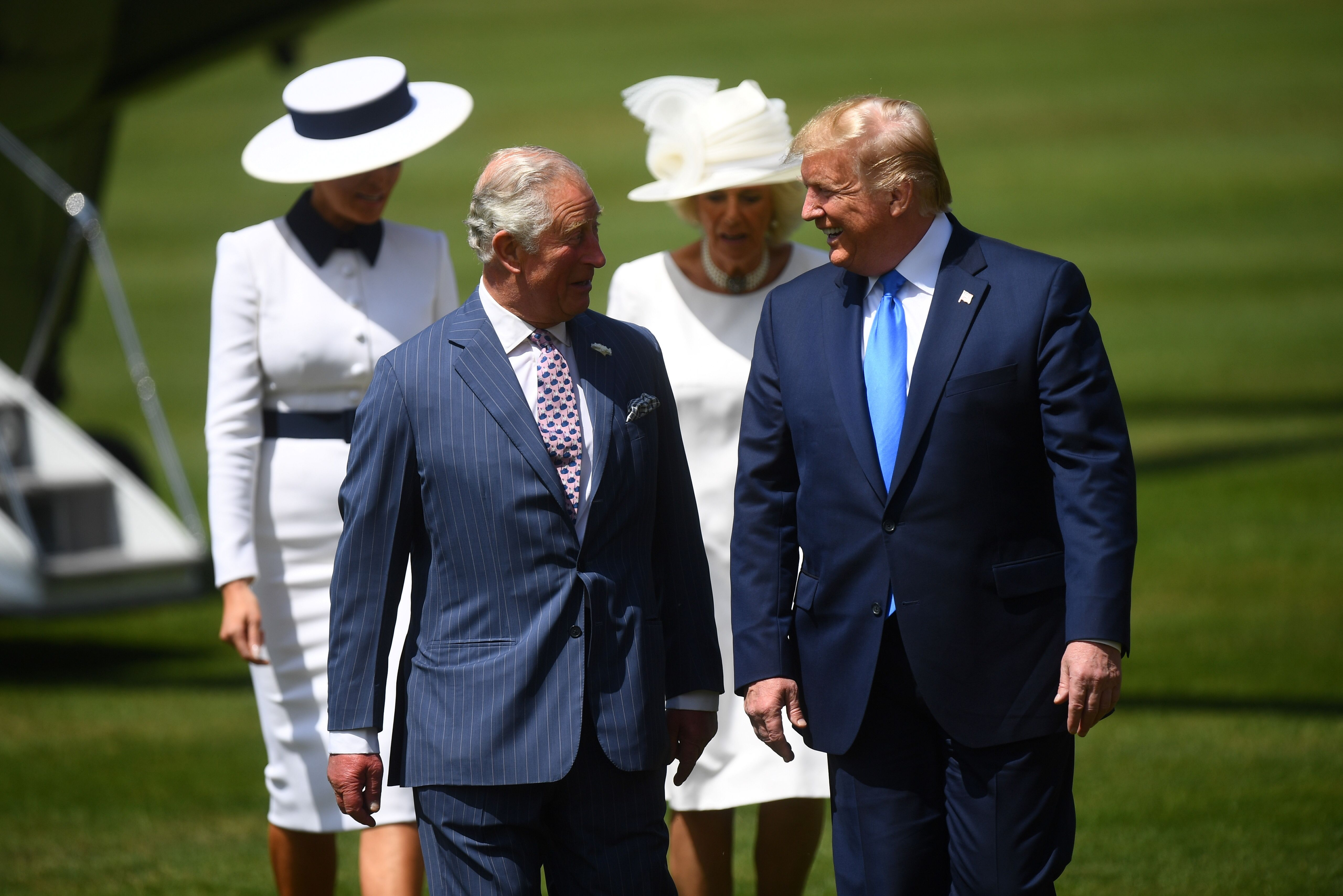US President Donald Trump (R) walks with Britain's Prince Charles, Prince of Wales (3R), and US First Lady Melania Trump (L) walks with Britain's Camilla, Duchess of Cornwall as they arrive for a welcome ceremony at Buckingham Palace in central London on June 3, 2019, on the first day of the US president and First Lady's three-day State Visit to the UK. - Britain rolled out the red carpet for US President Donald Trump on June 3 as he arrived in Britain for a state visit already overshadowed by his outspoken remarks on Brexit. (Photo by Victoria Jones / POOL / AFP)        (Photo credit should read VICTORIA JONES/AFP/Getty Images)